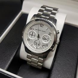 Женские наручные часы Michael Kors CWC140